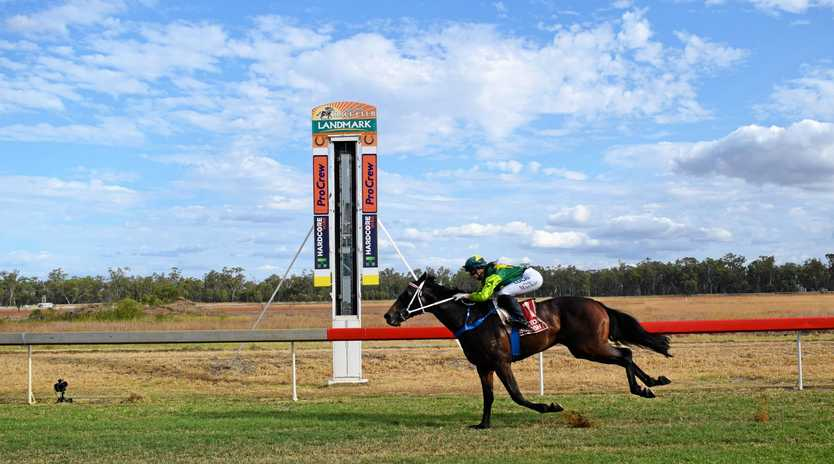 CHAMPION: Brooke Mackie on Red Prince takes the win in the McDonald's Open Handicap at the McDonald's Family Race Day in Chinchilla on Saturday.
