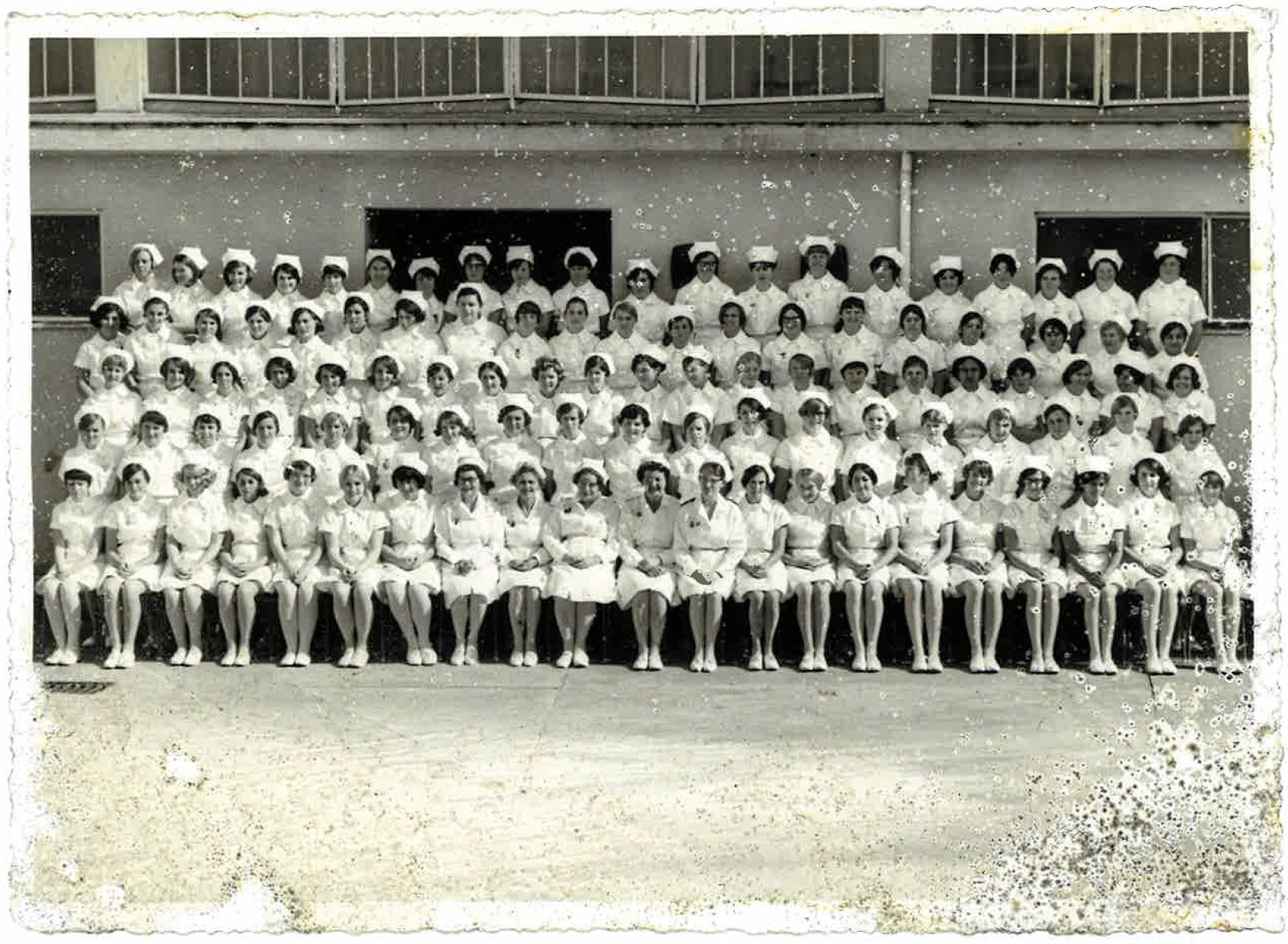 The mysterious nurses photo that was found in a gutter a couple of weeks ago. Doreen Voigt is in the front row, ninth from the left.