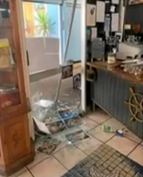 The damage left after thieves smashed their way into Barnacles Cafe at Tin Can Bay before helping themselves to the till and fridge.
