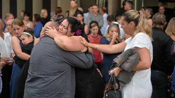 Lisa Harwick is consoled after the memorial service for her husband Brad Hardwick.