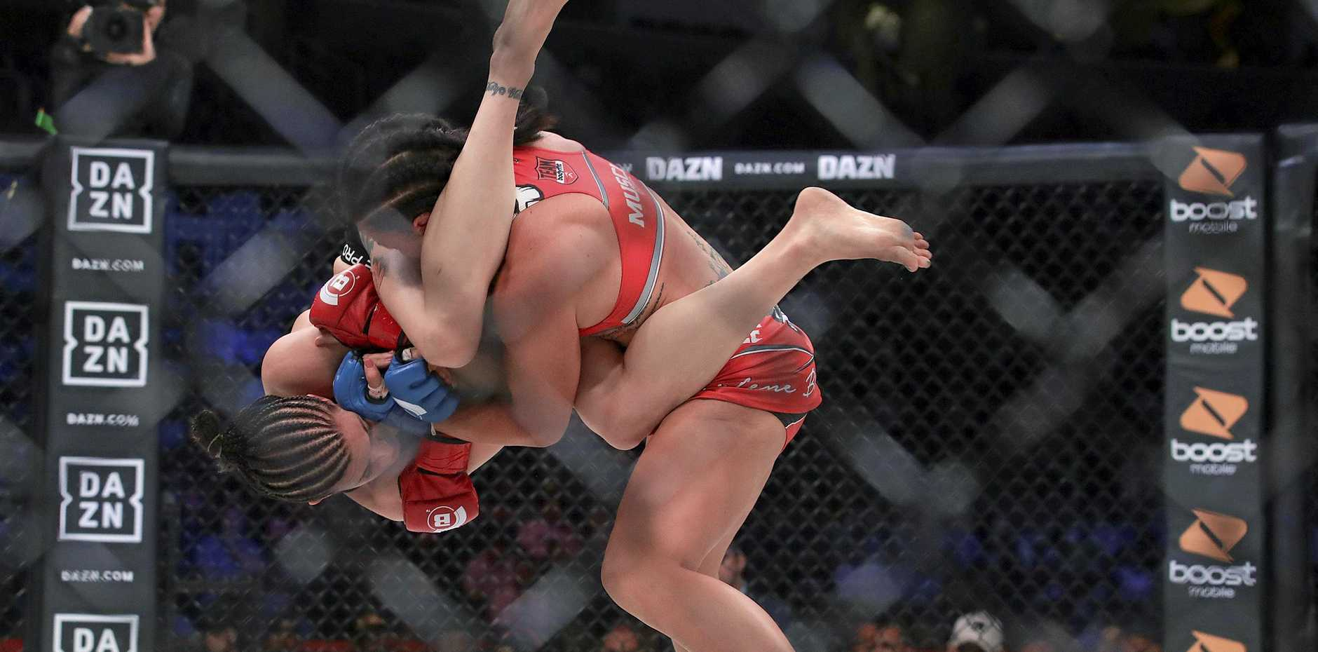 BACK IN THE GAME? Arlene Blencowe (top) slams Amber Leibrock during their featherweight mixed martial arts fight at Bellator 206 in San Jose, California, last September. Blencowe won by knockout in the third round. (AP Photo/Jeff Chiu)