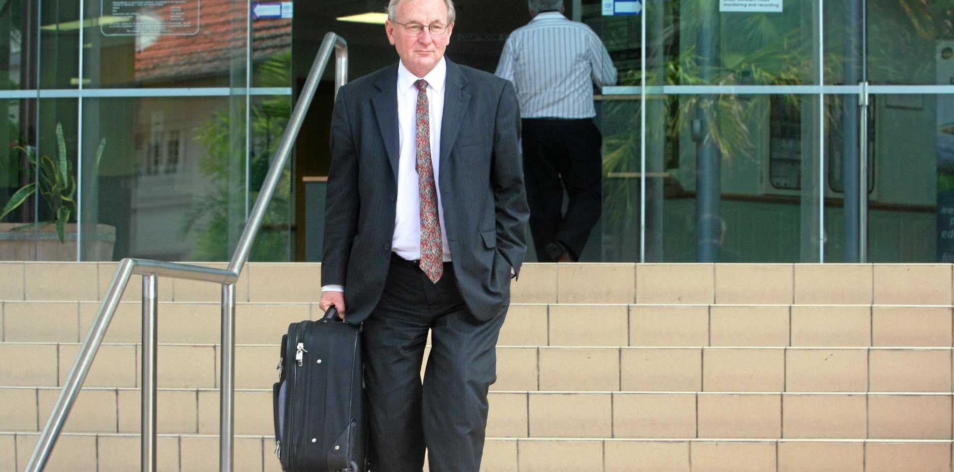 HIGH-PROFILE criminal lawyer Doug Winning leaving the Rockhampton Court House.