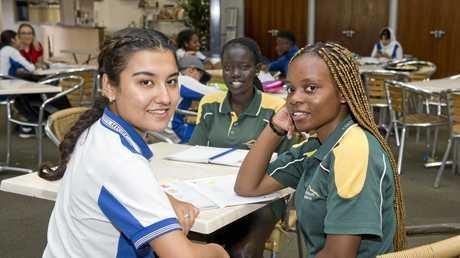 LEARNING WORLD: Benefiting from the Humeridge Homework Help program are (from left) Naheeda Nouroz Ali, 17, Monica Mach, 16 and Nyengela Mwajuma, 16.