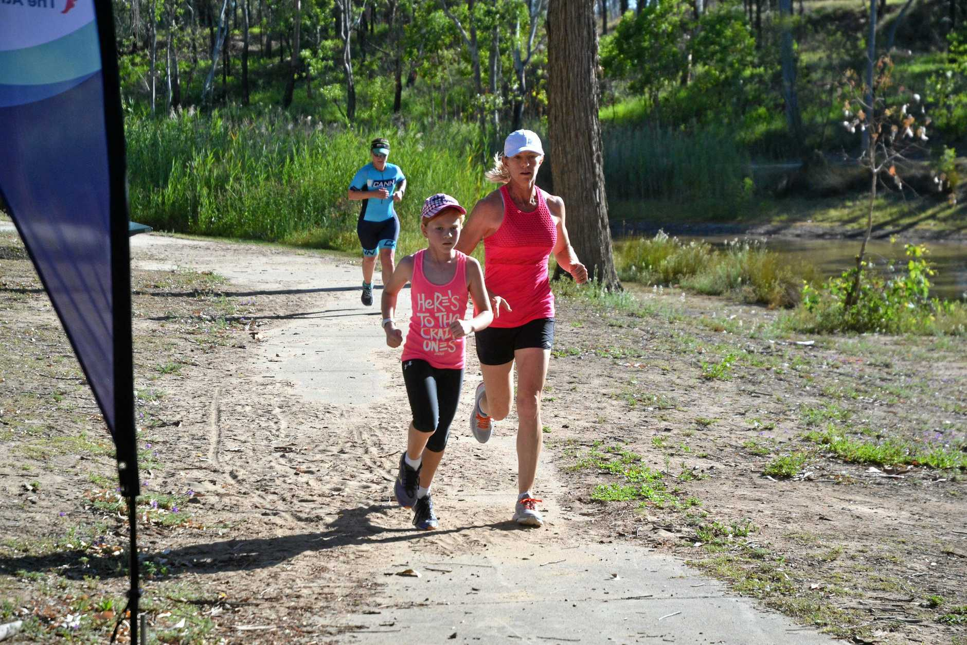 FUN AND FIT: Kealey and Janet Harland, and behind them Elaina Riebe at the Miles parkrun.