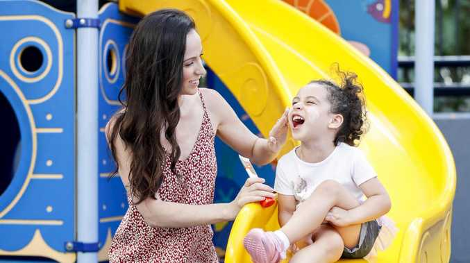 Rebecca Lolohea from Worongary applies sunscreen to daughter Tiare, 3. Pic Tim Marsden
