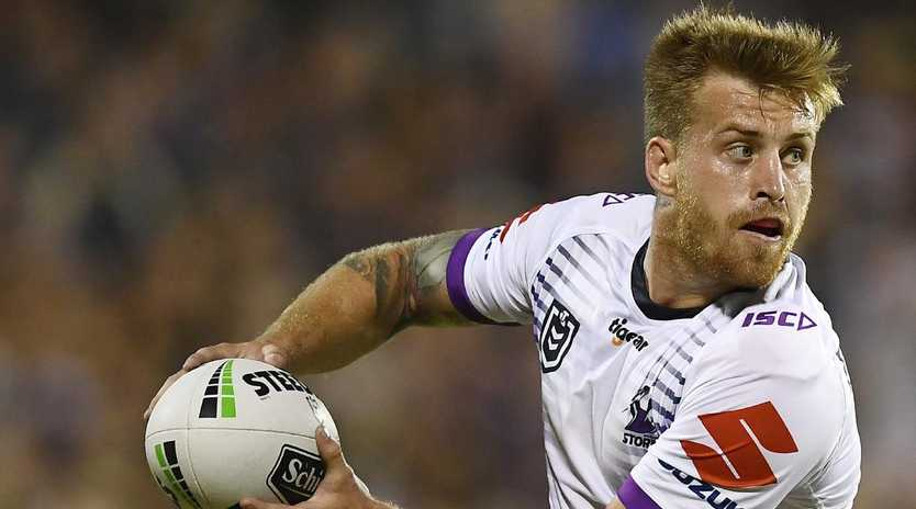 Cameron Munster will line up in the halves for the Storm. (Photo by Ian Hitchcock/Getty Images)