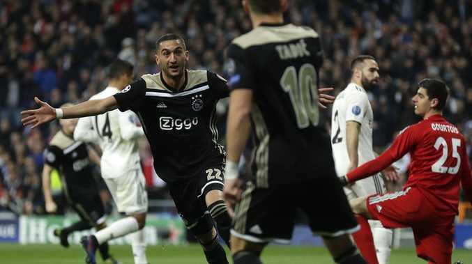 Jubilation! Ajax's Hakim Ziyech celebrates scoring the opening goal in the epic Champions League upset.