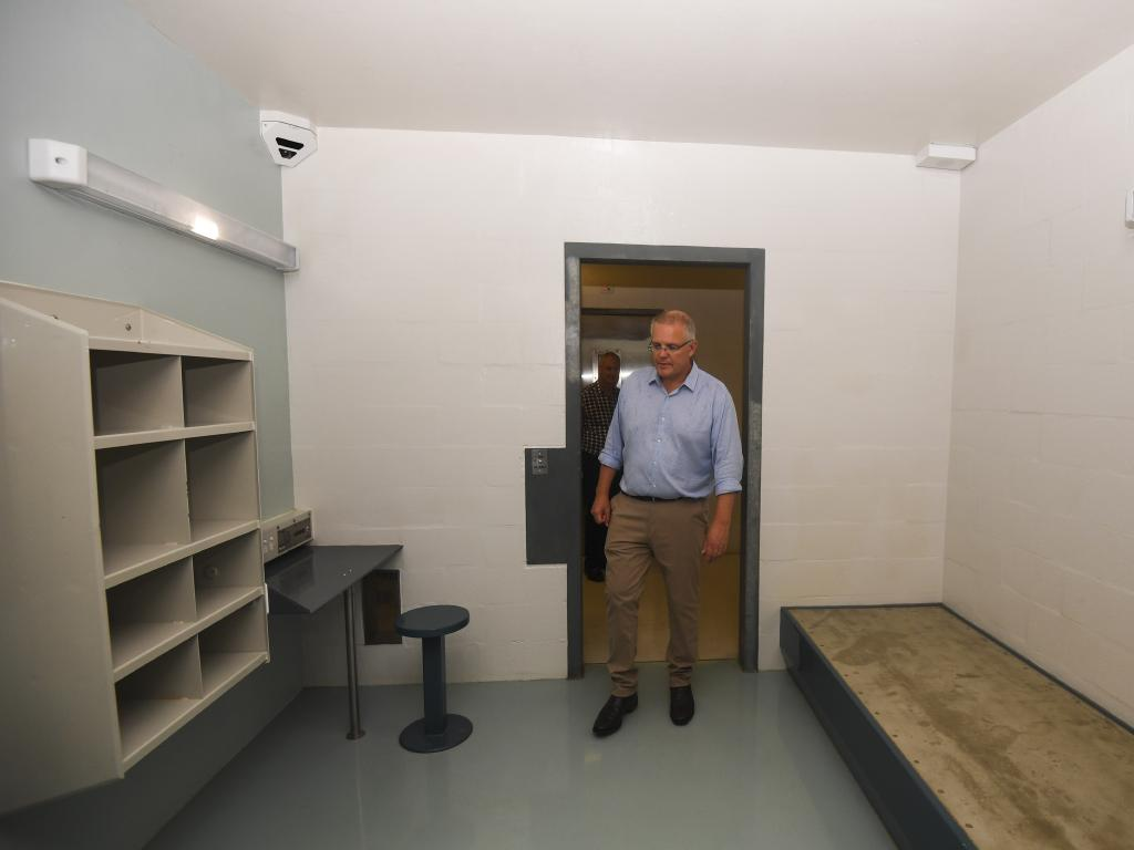 Australian Prime Minister Scott Morrison is seen inside a 'high care accommodation room' as he tours North West Point Detention Centre on Christmas Island. Picture: AAP