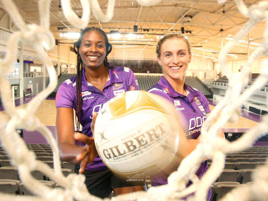 Romelda Aiken with captain Gabi Simpson in their new stadium.