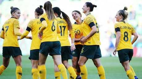 Matildas players celebrate Sam Kerr's early goal against Argentina