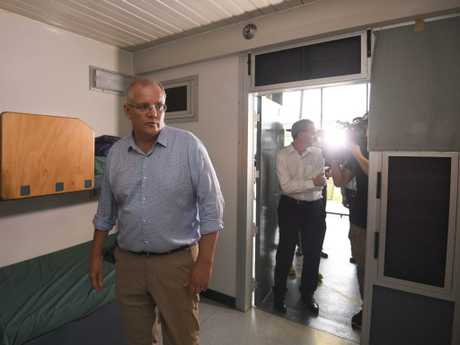 Australian Prime Minister Scott Morrison takes a look at accommodation facilities as he tours North West Point Detention Centre on Christmas Island. Picture: AAP