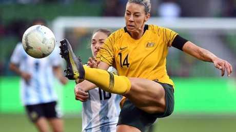Alanna Kennedy clears the ball against Argentina