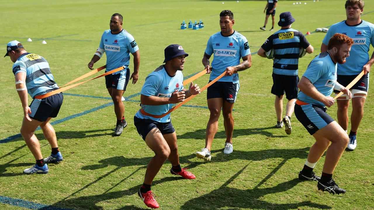 Karmichael Hunt training with former Origin teammate Israel Folau. Picture: Brett Costello
