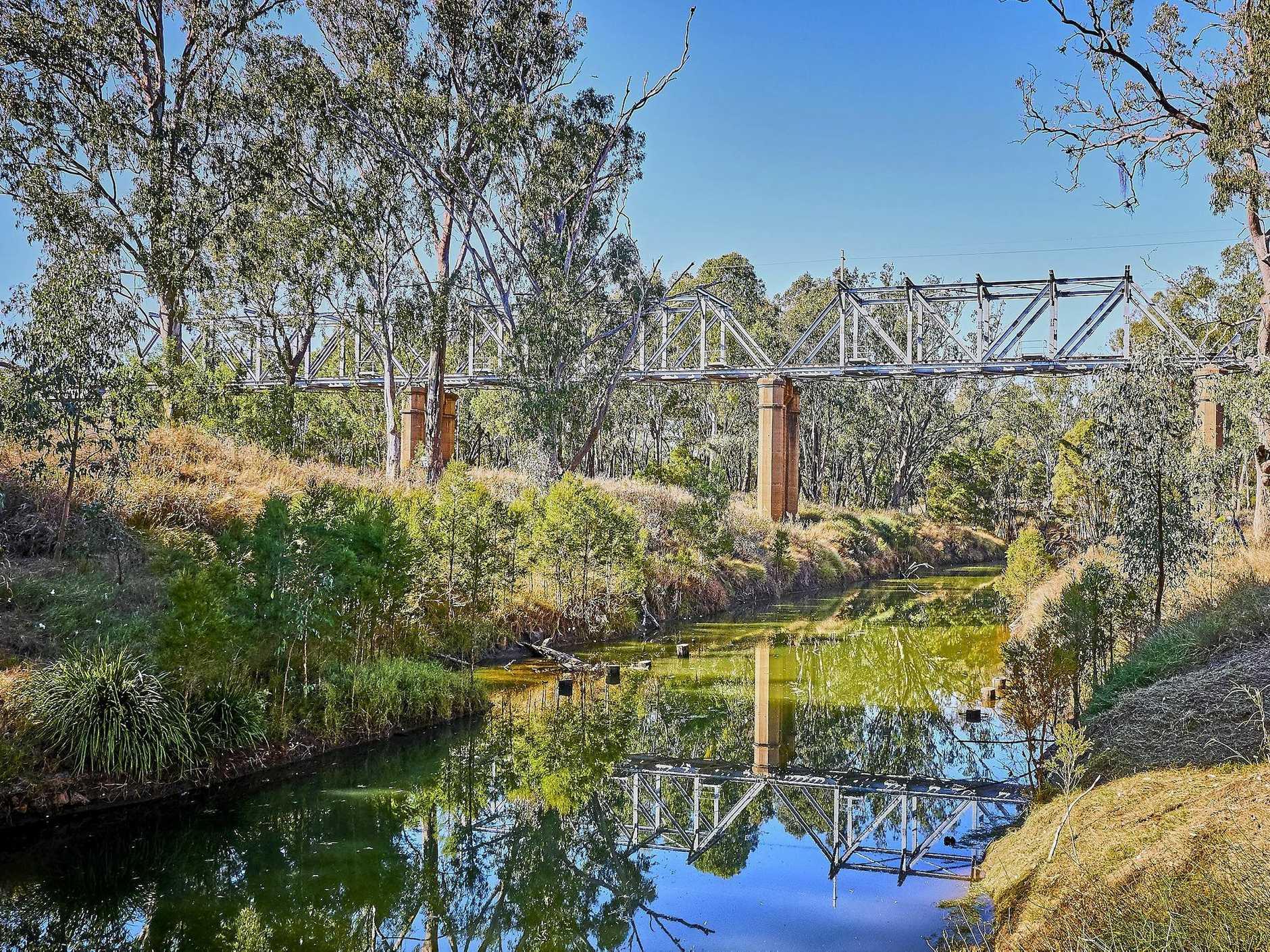 HISTORY: The original timber bridge at Comet was built in 1878.