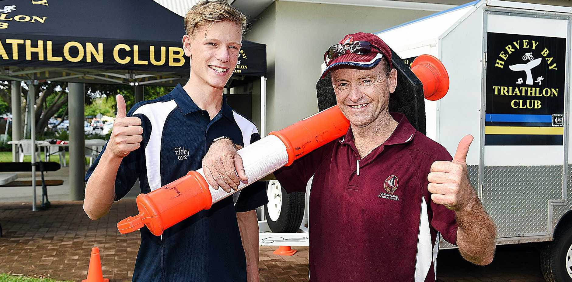 WORKING HARD: Getting ready for the Qld Schools State Triathlon at Torquay are Wide Bay triathlete Toby Powers and event organizer Brian Harrington.