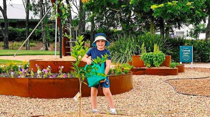 YOUNG GARDENER: Oscar Muller, one of the young Edenbrook residents who loves spending time in the Community Garden.