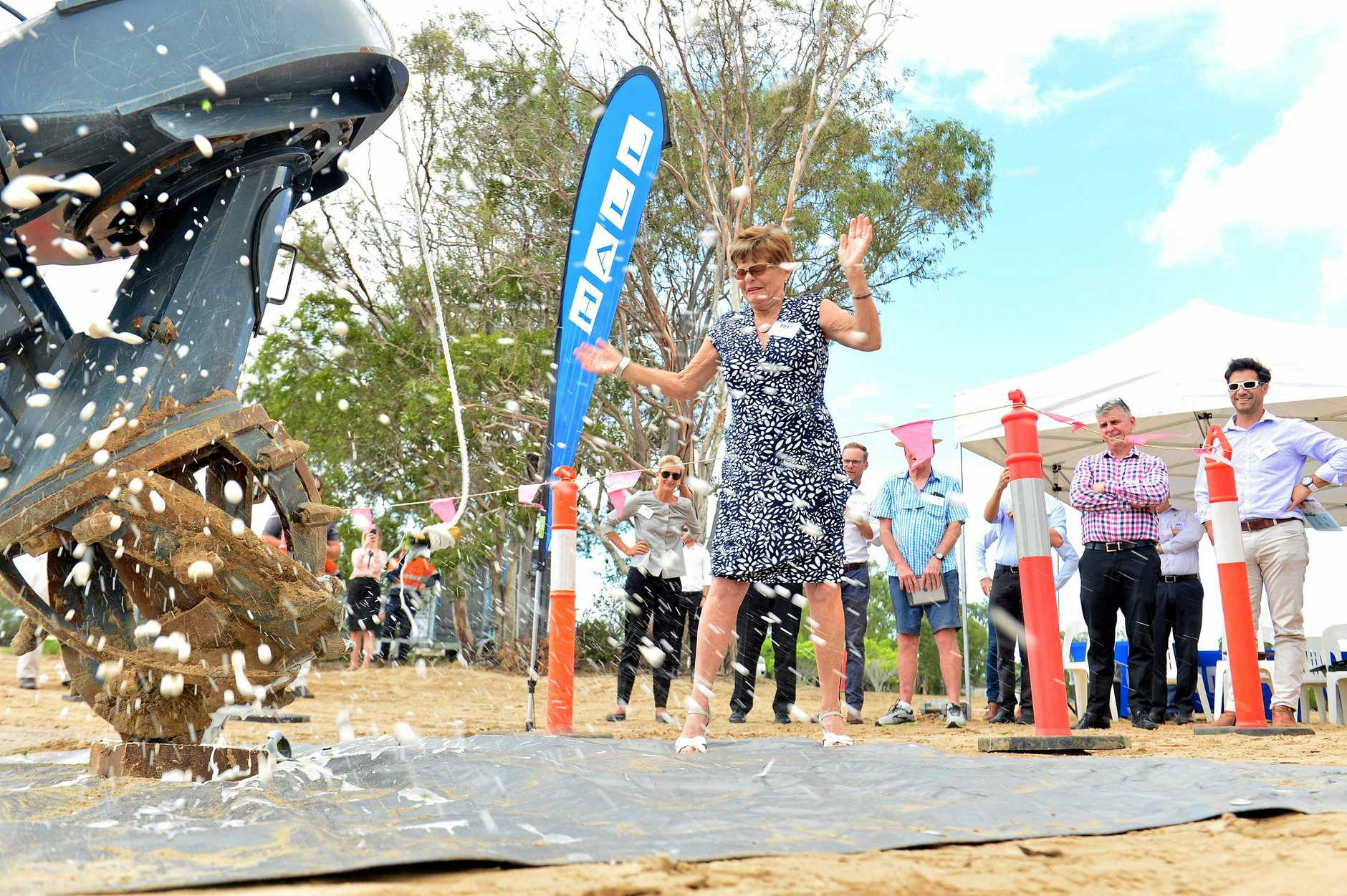 SMASHING CHAMPAGNE: Helen Hall of Hall Contracting officially christens the new state-of-the-art amphibious dredge that will help maintain local waterways.