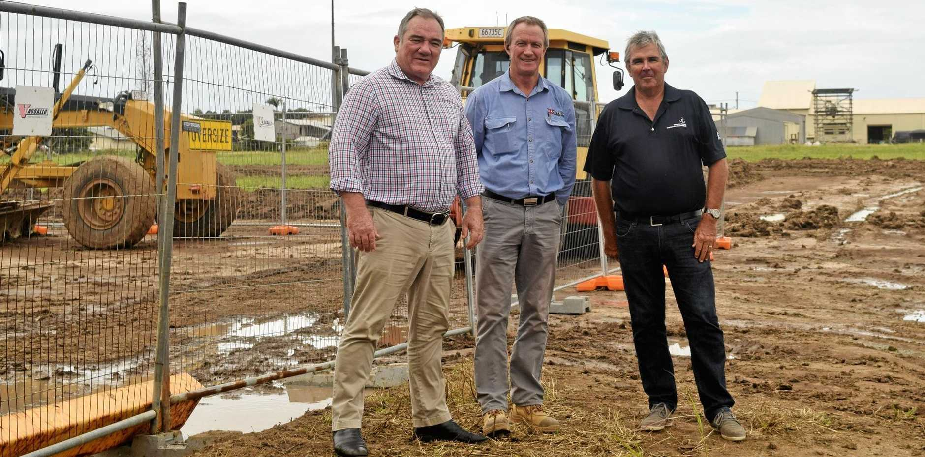 UNDER CONSTRUCTION: Mark Kelly from Knight Frank, Vassallo Constructions project manager Mark Bowler and investor and owner Peter Woolcock.
