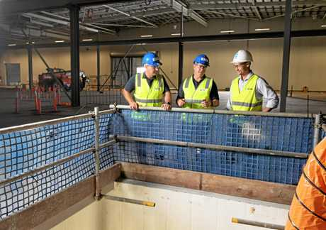 NEW PURPOSE: TAE Aerospace project manager Tibor Ban and CEO Andrew Sanderson, with ICON project manager Angus Walker at the Bundamba site.