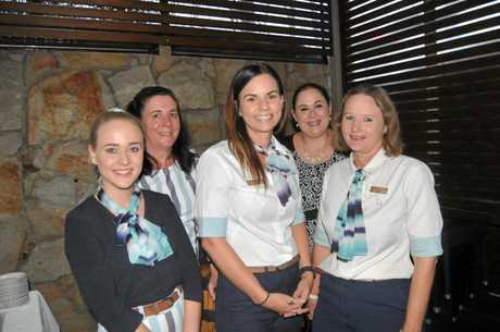 Dannii Herron, Bridget Connolly, Jenna Dudley, Tammara Walker and Julia Lomax celebrate Ms White's decade at the top of Gympie's Bank of Queensland.