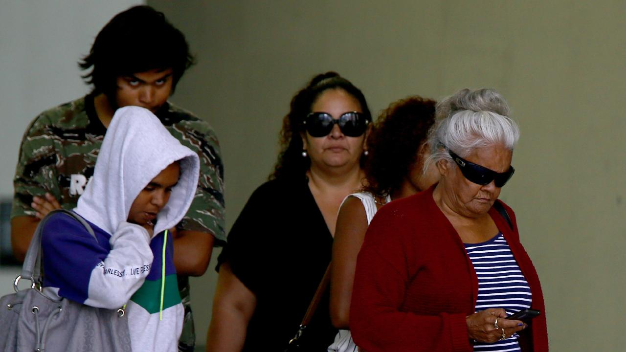 The families of Dina Bond and Shane Simpson leave the Brisbane Supreme Court. Picture: AAP/David Clark