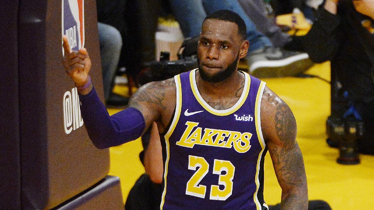 LeBron James celebrates beating Michael Jordan's point scoring record.