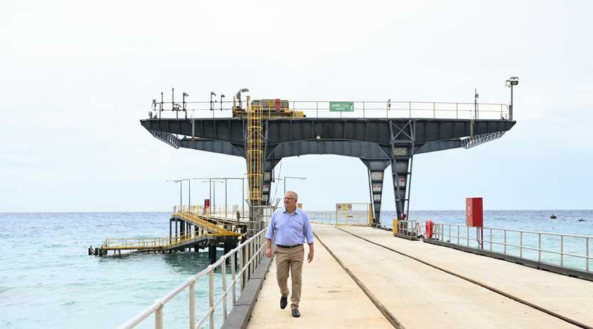 Australian Prime Minister Scott Morrison poses for photographs on the Christmas Island jetty on Christmas Island. Picture: AAP/Lukas Coch