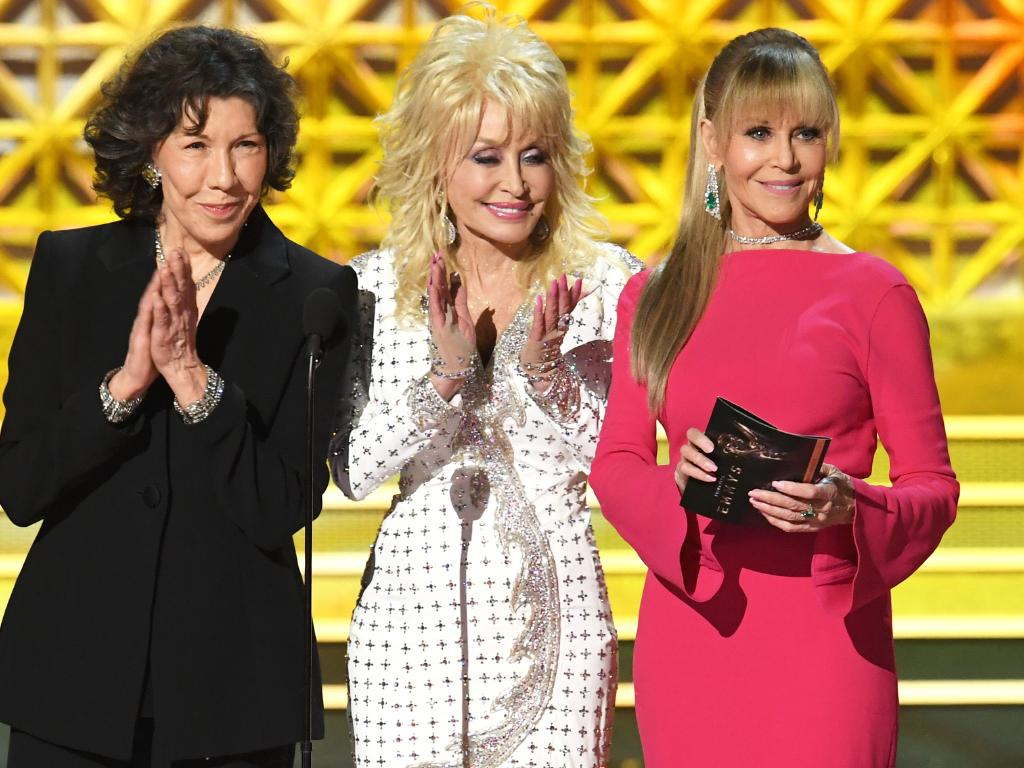 Lily Tomlin, Dolly Parton and Jane Fonda at the 2017 Emmys. Tomlin and Fonda took a swipe at Donald Trump, while Parton stayed quiet. Picture: Getty Images
