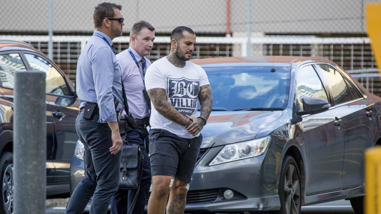 Bikie and MMA fighter Gokhan Turkyilmaz being brought into the Southport Watchhouse. Picture: Jerad Williams.