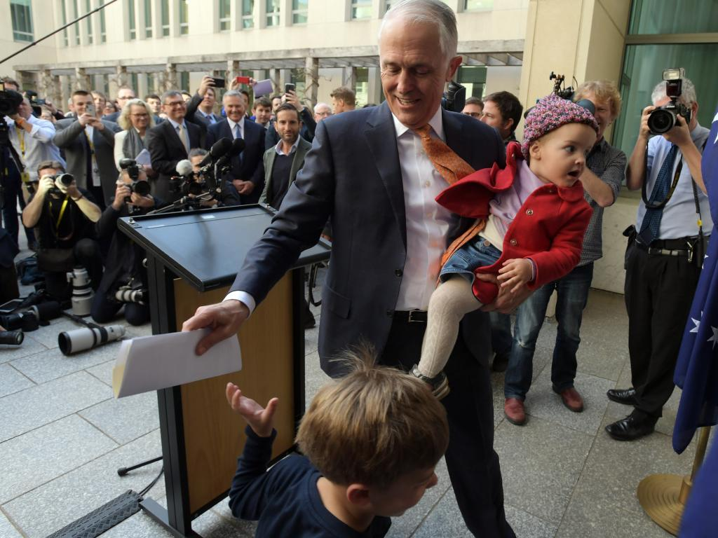 Former Australian Prime Minister Malcolm Turnbull departs his farewell press conference with grandchildren Jack (below) and Alice at Parliament House in Canberra. Picture: AAP