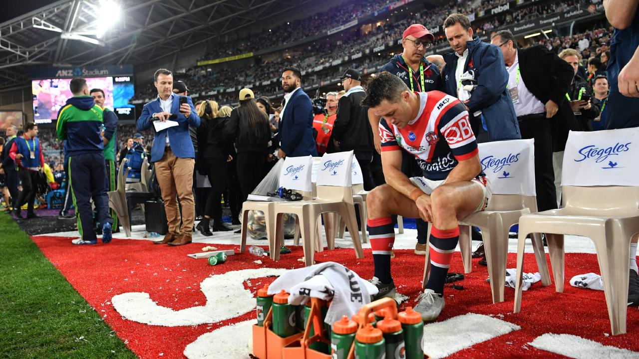Cooper Cronk sits on the sideliens with his broken shoulder blade after the 2018 NRL grand final. Picture: NRL Media