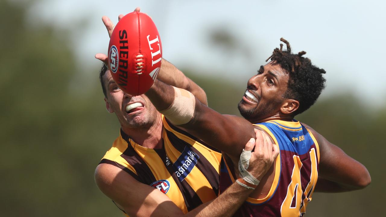 Jonathon Ceglar of the Hawks and Archie Smith of the Lions compete for the ball during the 2019 JLT Community Series AFL match at Moreton Bay Sports Complex. Pic: Getty Images
