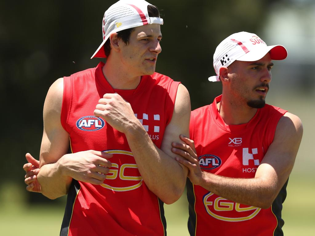 Chris Burgess and Izak Rankine during a Gold Coast Suns AFL training session on November 26, 2018 in Gold Coast, Australia. (Photo by Chris Hyde/Getty Images)