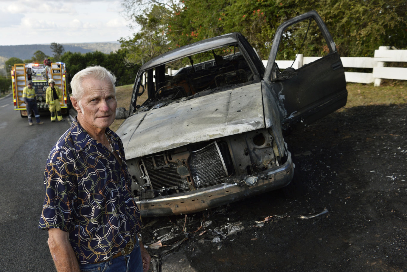 Owner Terry Hill inspects the ute after the fire.