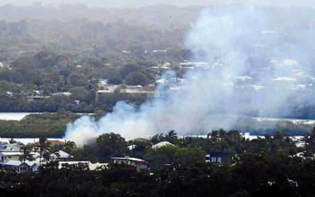 Smoke billowing from a Noosaville home that had fire fighters working overtime to contain yesterday afternoon.