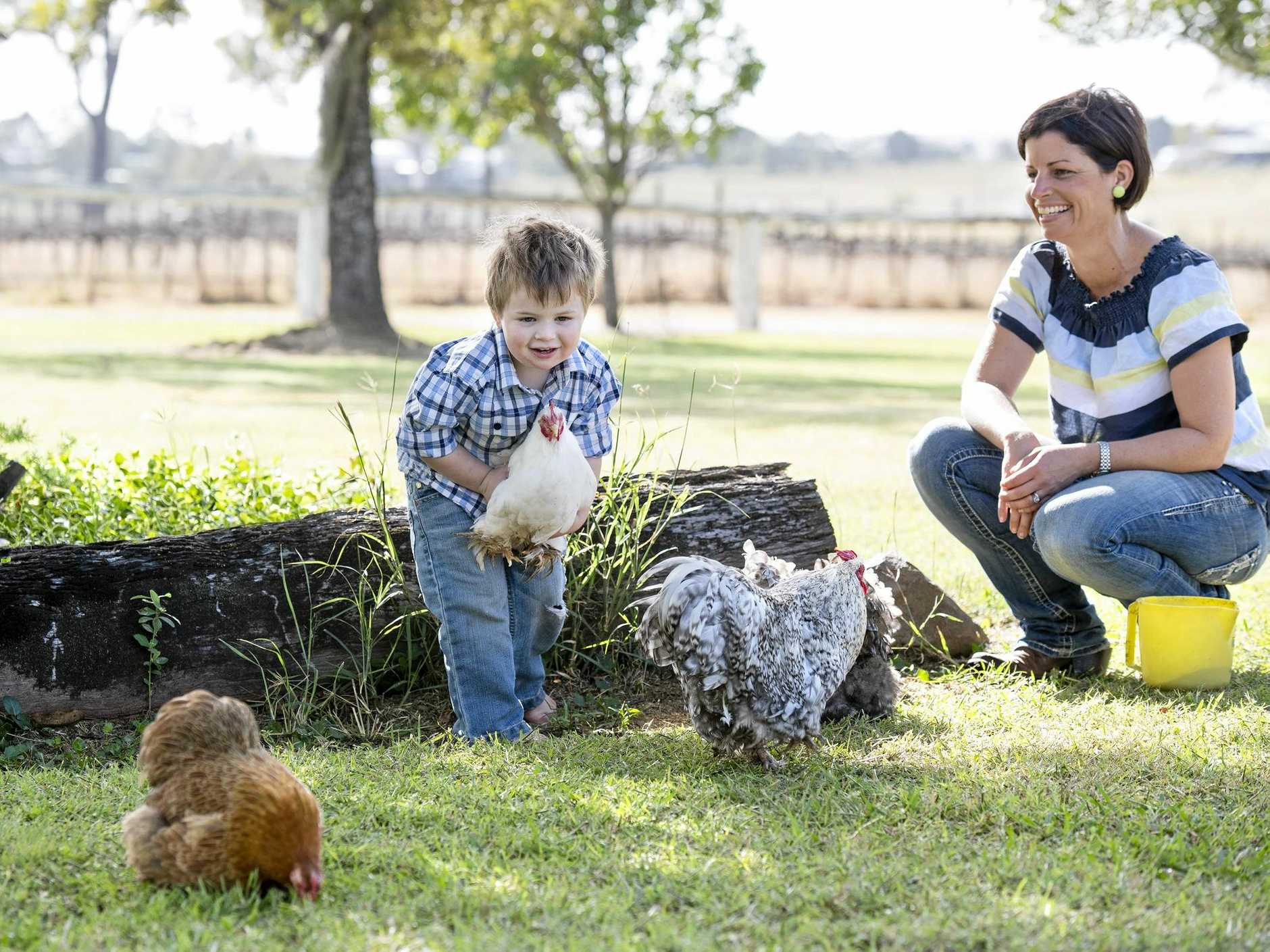 FRESH START: Tina Kenyon and her son play at the Hidden Gold Homestead in Moffatdale.