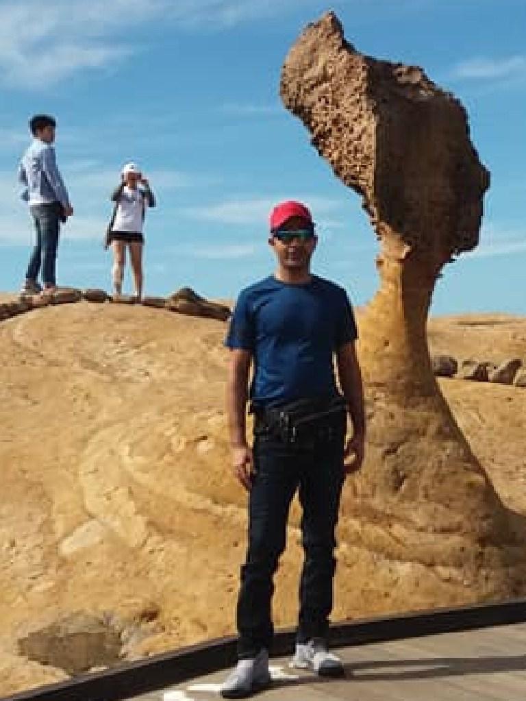 Nisar Haji poses near a formation in Taiwan (Facebook image)