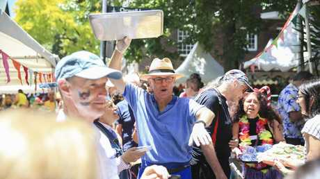 Former prime minister Malcolm Turnbull remains a popular local in his former electorate, pictured here at the Wayside Chapel Christmas lunch and street party in Kings Cross. Picture: Dylan Robinson