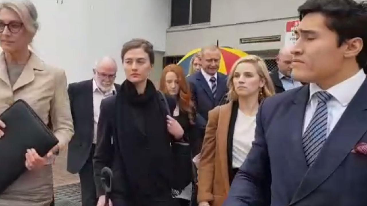 (L-R) Therese Cook, Yyani Cook-Williams (umbrella in hand), Clarissa Meredith (red hair) & Paul Cook (directly next to Clarissa) leaving Penrith court last year.