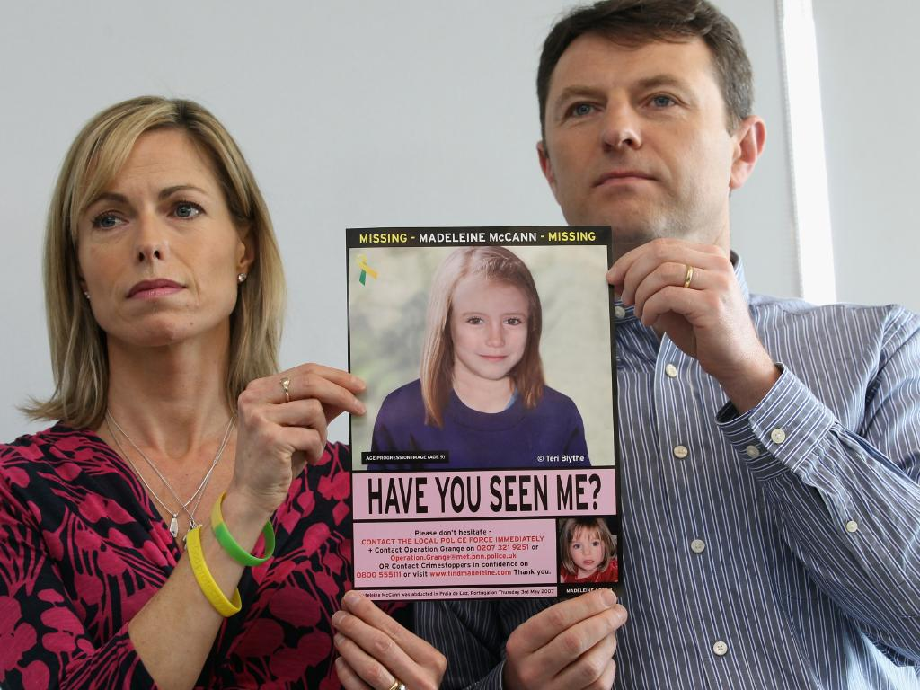 Kate and Gerry McCann hold an age-progressed image of their daughter to mark the fifth anniversary of Maddie's disappearance in 2012. Picture: Getty Images