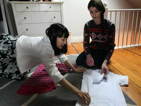 Otti Logan, 16, gets a folding lesson from zen tidiness guru Marie Kondo. Picture: Joanne Rathe/The Boston Globe via Getty Images