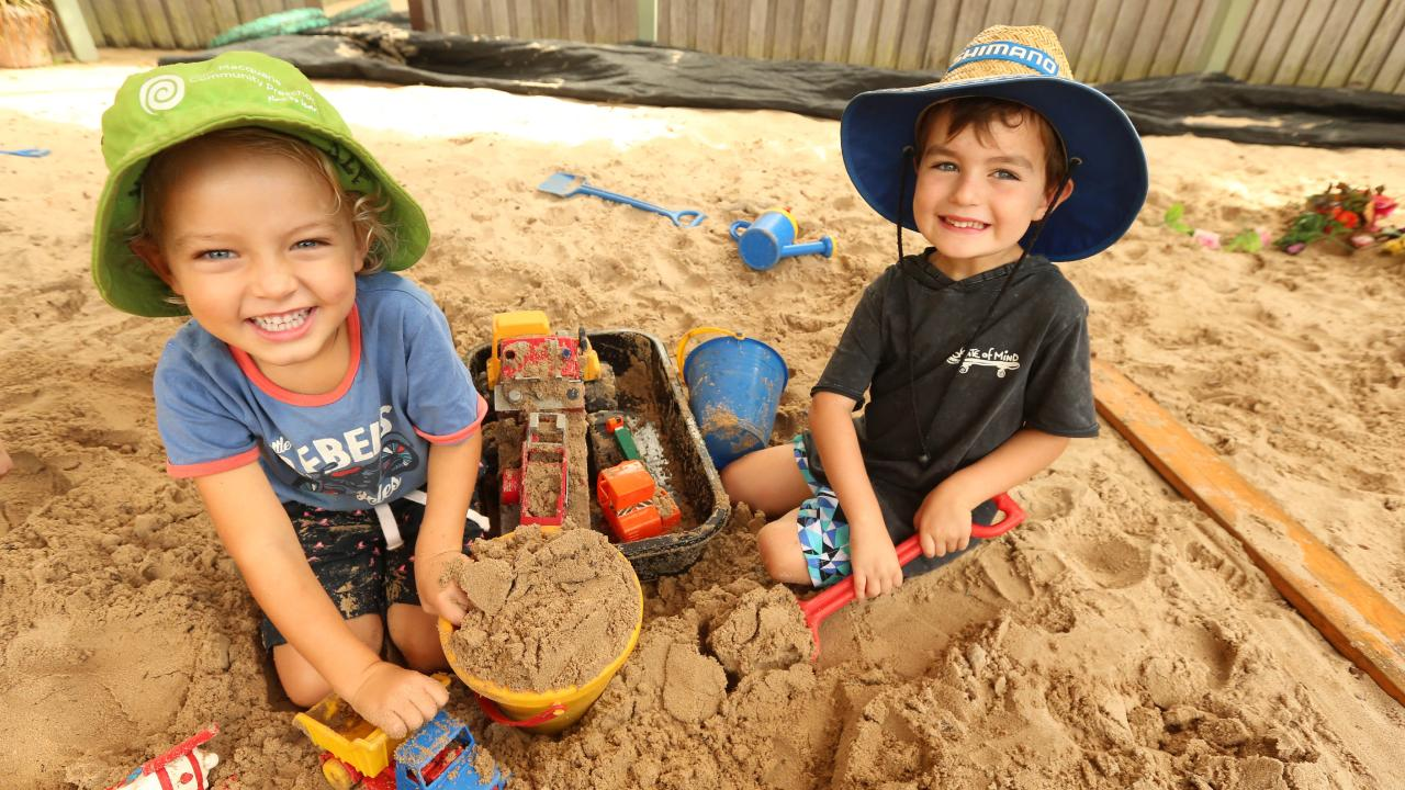 Sonny Wallace and Billy Moore have fun in the sandpit. Picture: Nathan Edwards.