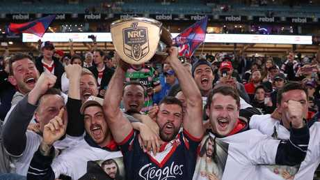 James Tedesco celebrates with fans after winning last year's premiership. Picture: Brett Costello