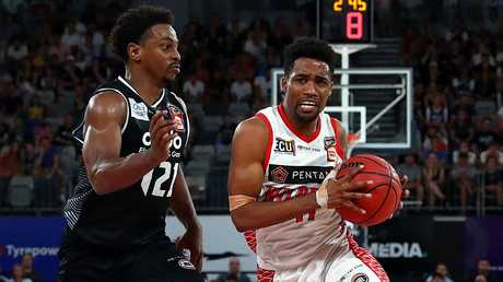 Bryce Cotton of the Wildcats handles the ball under defensive pressure against Melbourne United. Picture: Kelly Defina/Getty Images