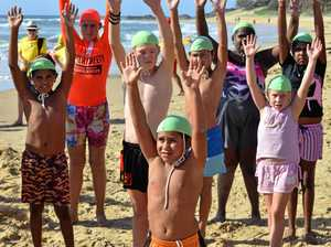 Magical morning as kids from the bush have first ocean swim