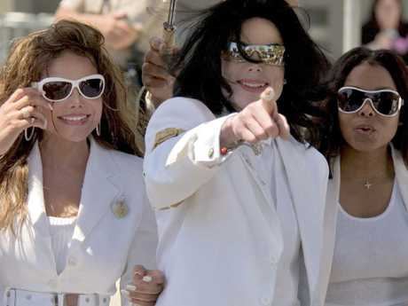 LaToya Jackson (L) with siblings Michael and Janet Jackson in 2004. Picture: AFP