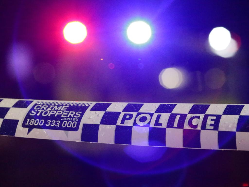 A man has been charged after he allegedly punched a 10-week-old boy, who was strapped to his father's chest in a carrier, following a dispute outside a pub.