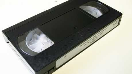 Please enjoy this generic image of a classic VHS cassette in its natural habitat.