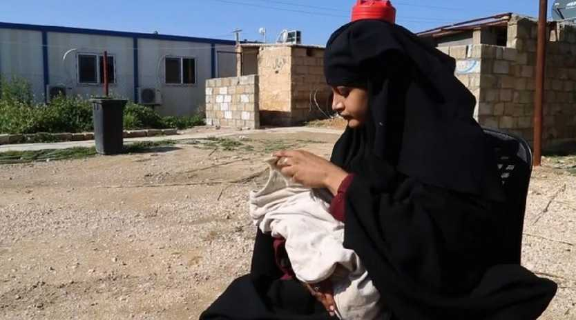 Shamima Begum with her baby boy in the al-Hawl refugee camp in Syria. Supplied