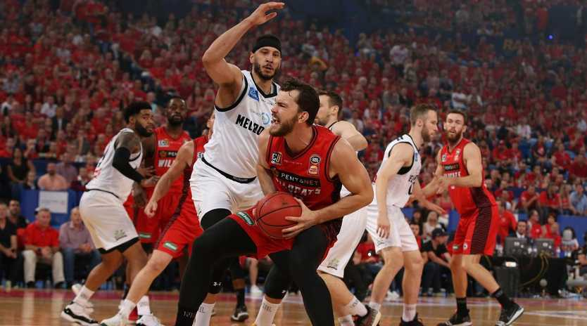 Josh Boone looks to shut down Wildcats rival Angus Brand. Picture: Getty